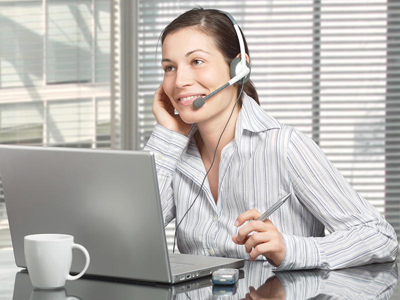 Person using headset and computer